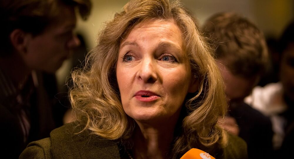 Lady Michele Renouf speaks to the media in support of Roman Catholic bishop Richard Williamson before he arrives at Heathrow airport in London, on February 25, 2009.