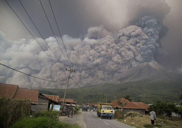 Mount Sinabung spews volcanic ash as it erupts in Kutarakyat, North Sumatra, Indonesia, Monday, Feb. 19, 2018