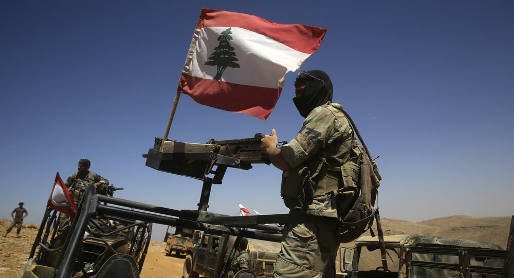 Lebanese soldiers sit on top of an armored personnel carrier (File)