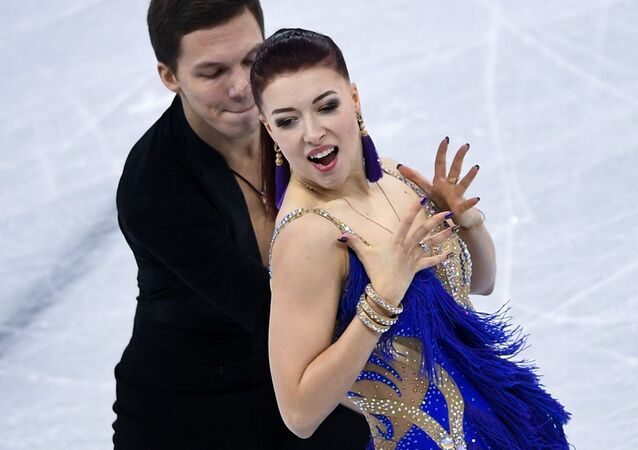 Yekaterina Bobrova and Dmitry Solovyov (Russia) perform their short program in the ice dance competition at the XXIII Olympic Winter Games