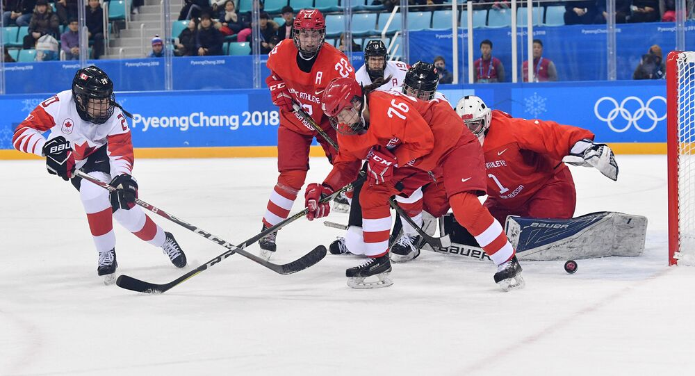 From left: Sarah Nurse (Canada) and Maria Batalova and Yekaterina Nikolayeva and goalie Valeria Tarakanova (Russia) during the semifinals between Canada and Russia in the women's ice hockey tournament at the 2018 Winter Olympics