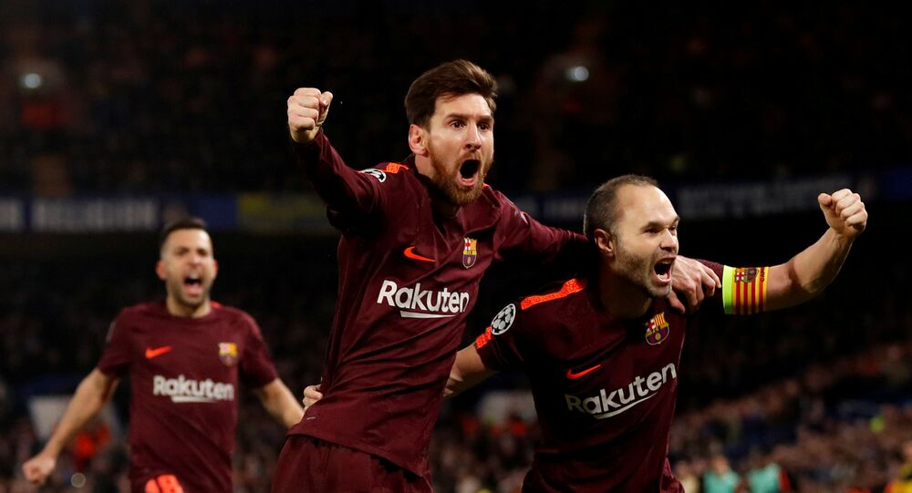 Soccer Football - Champions League Round of 16 First Leg - Chelsea vs FC Barcelona - Stamford Bridge, London, Britain - February 20, 2018 Barcelona's Lionel Messi celebrates scoring their first goal with Andres Iniesta