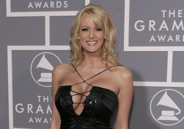 In this Feb. 11, 2007, file photo, Stormy Daniels arrives for the 49th Annual Grammy Awards in Los Angeles.
