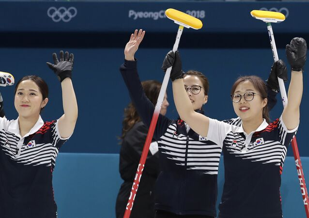 South Korean team celebrates after winning against Japan Denmark during their women's curling match at the 2018 Winter Olympics in Gangneung, South Korea, Wednesday, Feb. 21, 2018.