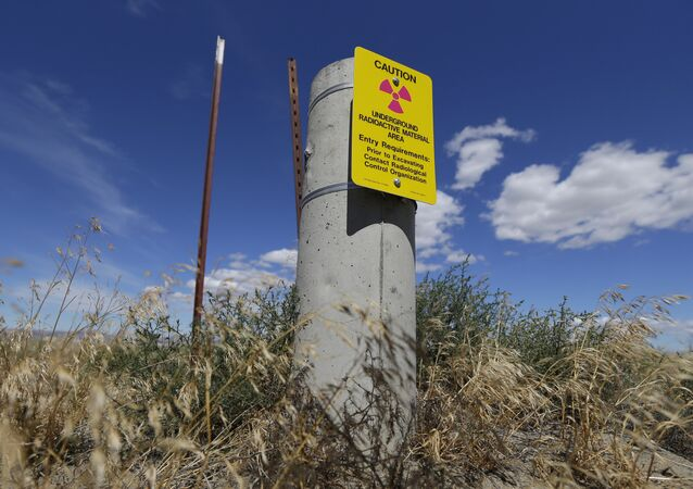 In this photo taken July 11, 2016, a sign warns of radioactive material stored underground on the Hanford Nuclear Reservation near Richland, Wash.