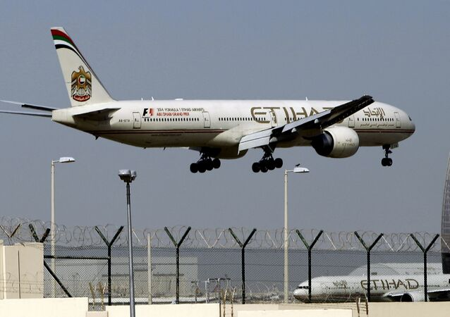 In this May 4, 2014 file photo, an Etihad Airways plane prepares to land at the Abu Dhabi airport in the United Arab Emirates
