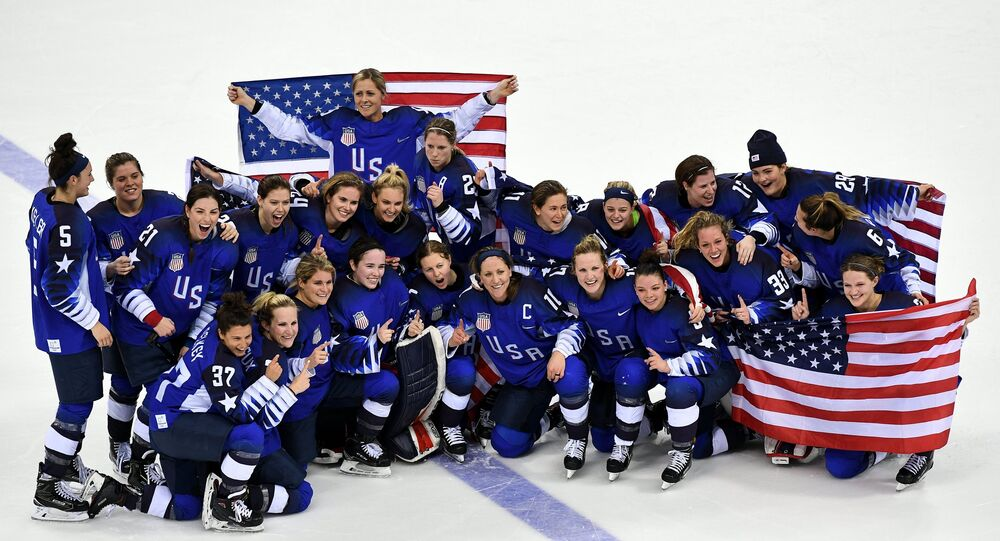 The US national team after the finals of the women's ice hockey tournament between Canada and the US at the XXXIII Winter Olympics