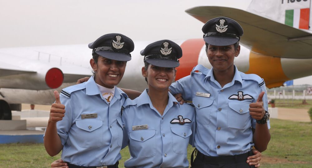 The first three women fighter pilots of the Indian Air Force, from left, Mohana Singh, Avani Chaturvedi and Bhawana Kanth pose for photographs after the graduation parade at the Indian Air Force academy in Dundigal, outskirts of Hyderabad, India, Saturday, June 18, 2016