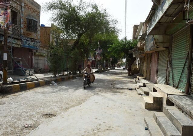Pakistani motorcyclist drives through a closed market during a hot day in Sibi, in Pakistan's southwestern Balochistan province. (File)