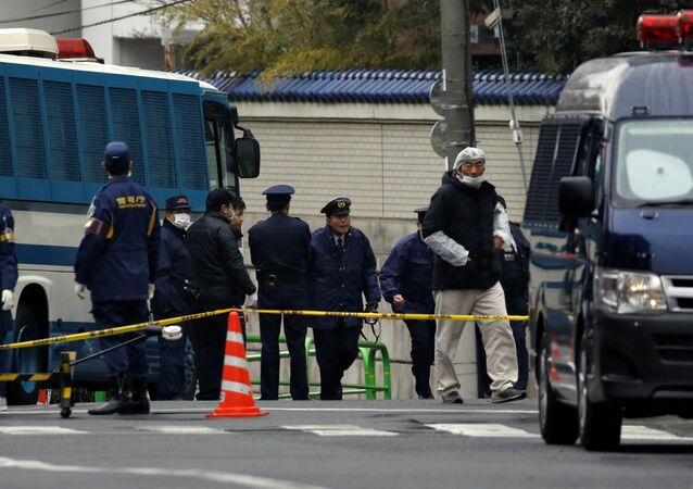Police officers are seen in front of the headquarters of the General Association of Korean Residents in Japan (Chongryon), after police arrested two men suspected of shooting in to the building in Tokyo, Japan, February 23, 2018