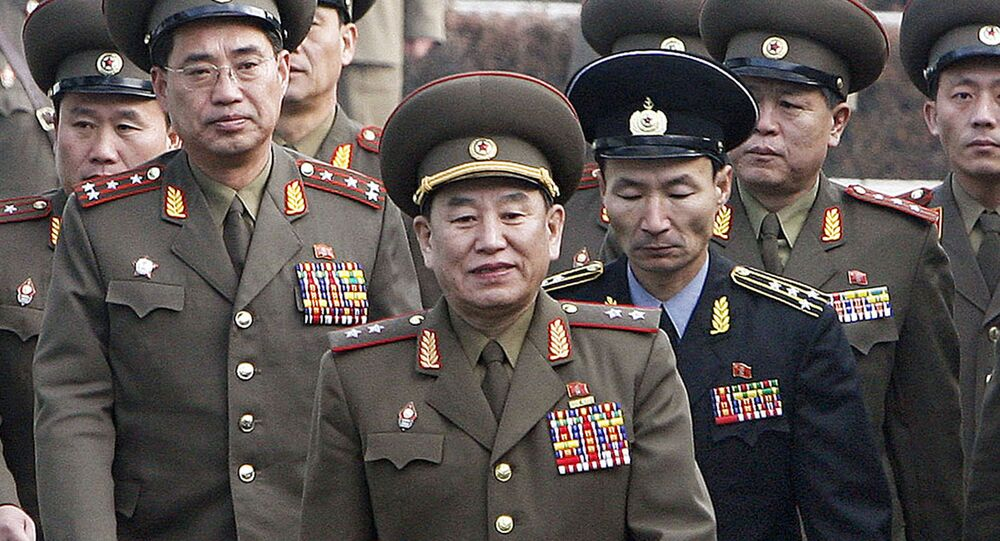 This file picture taken on December 13, 2007 shows North Korea's chief delegate Kim Yong Chol (C) and North Korean soldiers crossing the border which divides the two Koreas to attend the inter-Korean general talks at the South's side of the truce village of Panmunjom, in the Demilitarized Zone (DMZ) separating the two Koreas since 1950-53 Korean War