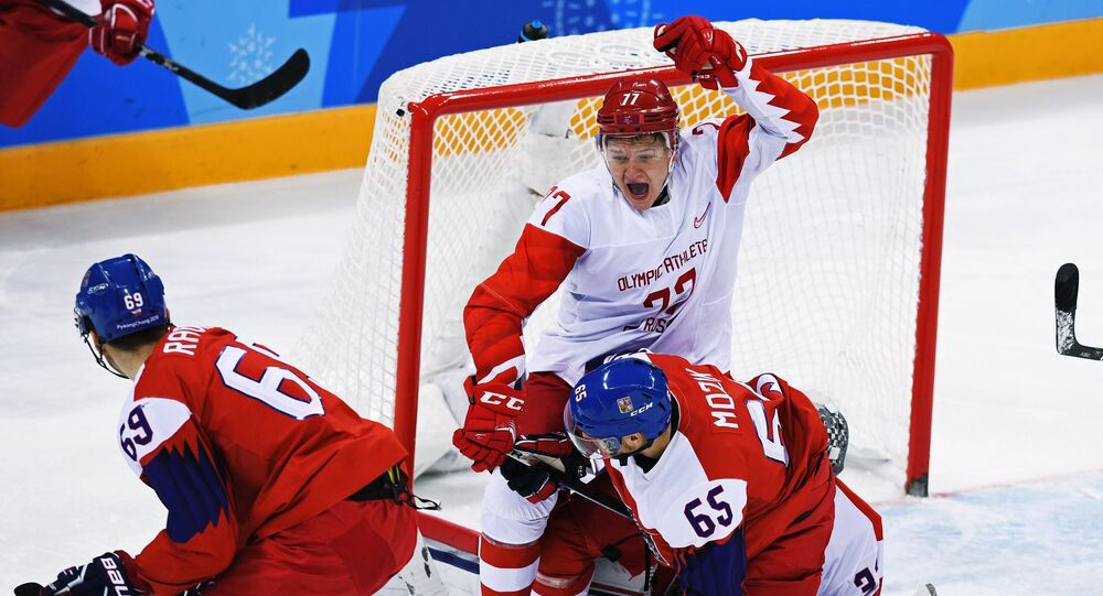 Vojtech Mozik (Czech Republic) and Kirill Kaprizov (Russia), right to left, during the semifinals between the Russia and Czech Republic national teams in the men's ice hockey tournament, at the XXIII Olympic Winter Games