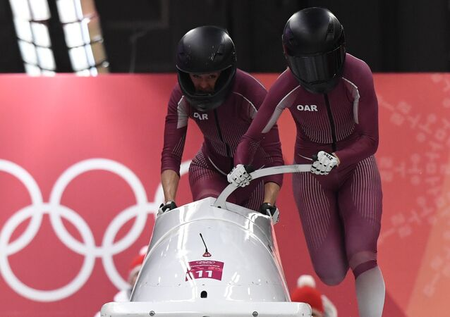 Russia's Nadezhda Sergeeva (R) and Russia's Anastasia Kocherzhova compete in the women's bobsleigh heat 1 run during the Pyeongchang 2018 Winter Olympic Games, at the Olympic Sliding Centre on February 20, 2018 in Pyeongchang