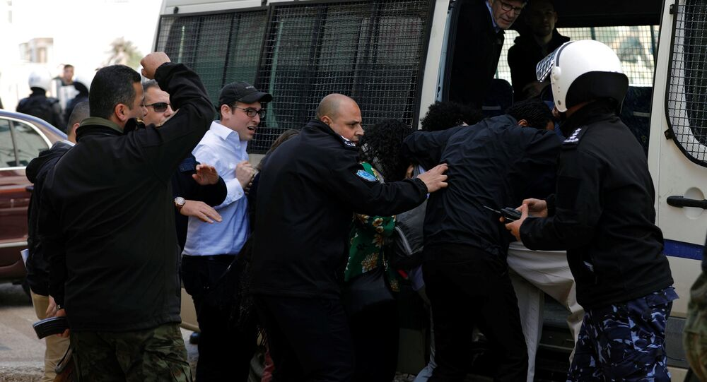 A U.S. delegation is evacuated by Palestinian police after they were attacked by Palestinian protesters in Ramallah, in the occupied West Bank February 22, 2018