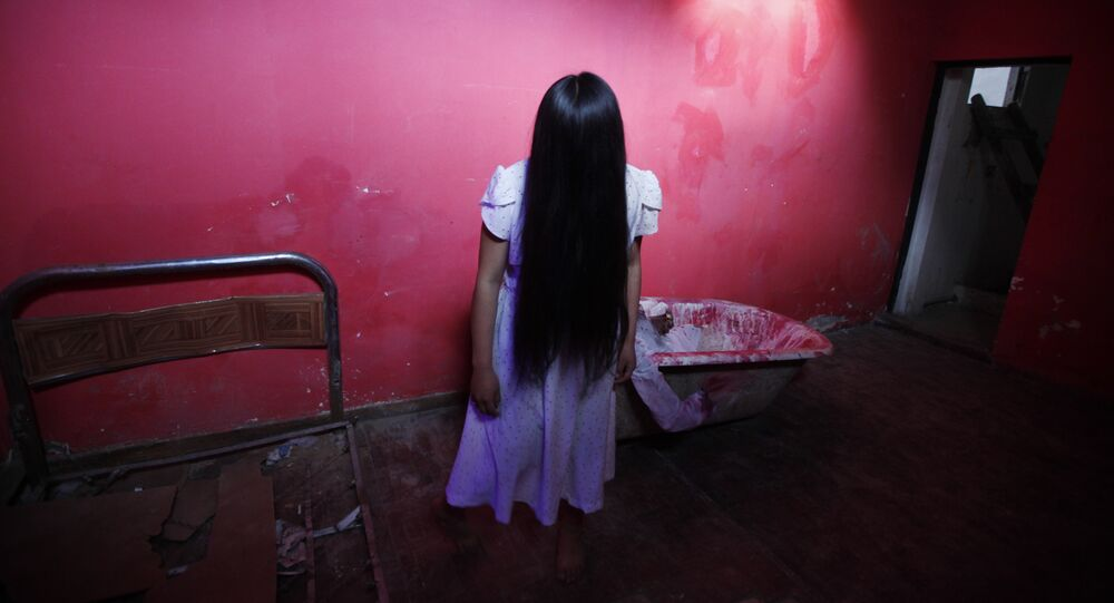 Lineth Mollo portrays Samara Morgan, the central character of 'The Ring' horror film, poses before performing at a House of Terror during a Halloween night in El Alto, Bolivia, Wednesday, Oct. 30, 2013