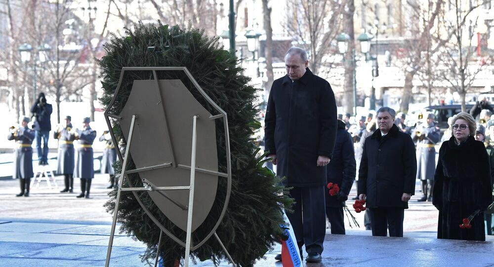 President Vladimir Putin during a wreath-laying ceremony at the Tomb of the Unknown Soldier at the Kremlin Wall, on Defender of the Fatherland Day.