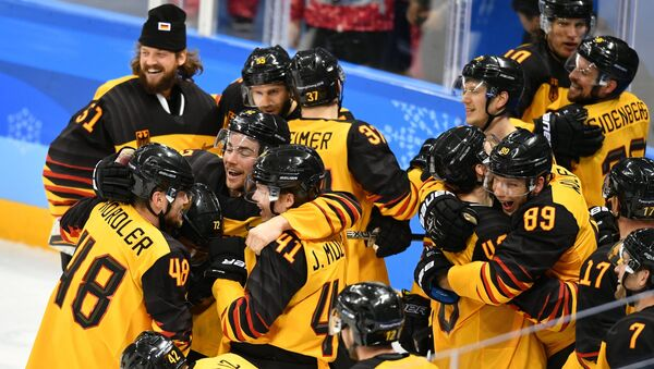 Germany's team members celebrate their victory in the semifinals between the Canada and Germany national teams in the men's ice hockey tournament, at the XXIII Olympic Winter Games - Sputnik International