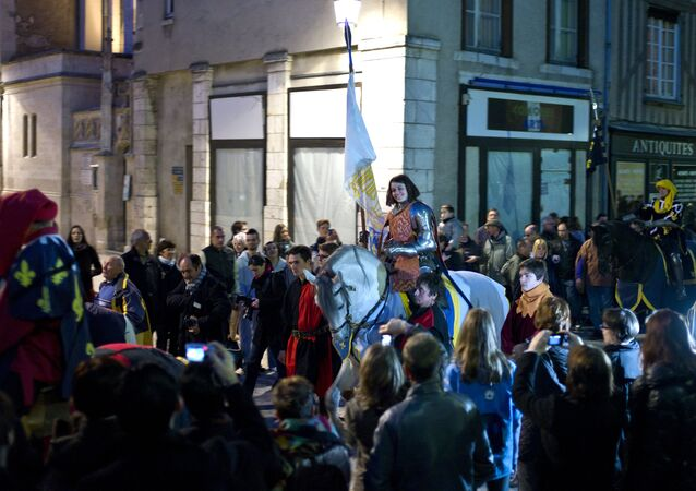 Pauline Finet performs as Joan of Arc during the opening ceremony of the 600th anniversary of the birth of Joan of Arc, in Orleans, central France. File photo