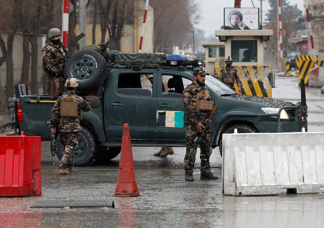 Afghan security forces keep watch at a check point near the site of a suicide attack in Kabul, Afghanistan February 24, 2018