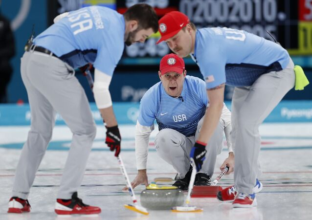 Curling - Pyeongchang 2018 Winter Olympics - Men's Final - Sweden v U.S. - Gangneung Curling Center - Gangneung, South Korea - February 24, 2018 - Skip John Shuster of the U.S. watches the shot as his teammates, lead John Landsteiner and second Matt Hamilton, sweep