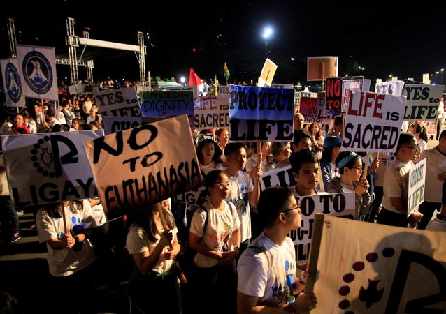 Participants display placards as they participate in a procession against plans to reimpose death penalty and intensify drug war during Walk for Life in Luneta park, Metro Manila, Philippines February 24, 2018