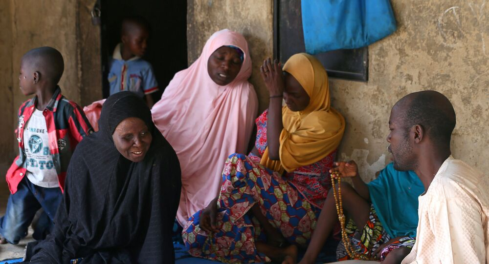 Relatives of missing school girls react in Dapchi in the northeastern state of Yobe, after an attack on the village by Boko Haram, Nigeria February 23, 2018