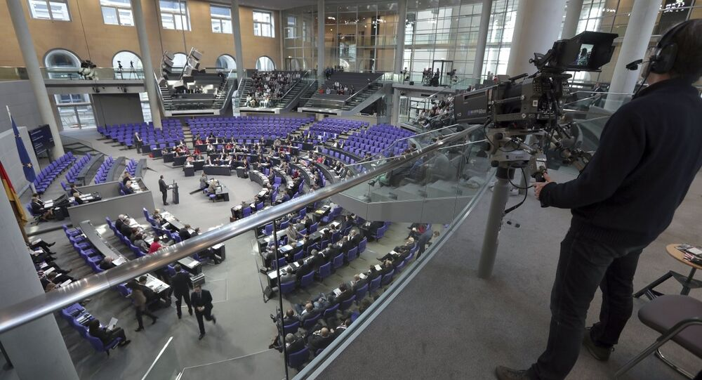 In this Friday, Feb. 2, 2018 photo a cameraman films a meeting of the German Federal Parliament, Bundestag, at the Reichstag building in Berlin, Germany.