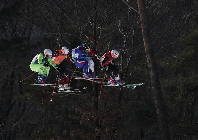 David Duncan of Canada (2nd from left) run the men's ski cross small final course during the 2018 Winter Olympics in Pyeongchang, South Korea, Wednesday, Feb. 21, 2018.