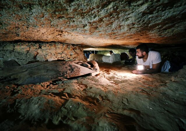 Egyptian antiquities worker is seen inside the recently discovered burial site in Minya, Egypt February 24, 2018
