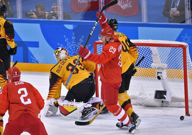 From left: Frank Hordler (Germany), Ilya Kablukov (Russia) and Danny aus den Birken (Germany) during the final match between Russia and Germany in the men's ice hockey tournament at the 2018 Winter Olympics.