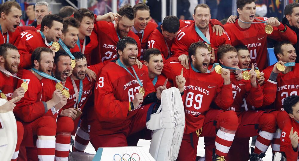 Ice Hockey - Pyeongchang 2018 Winter Olympics - Men's Final Match - Russia - Germany - Gangneung Hockey Centre, Gangneung, South Korea - February 25, 2018 - Russian team reacts with their gold medals