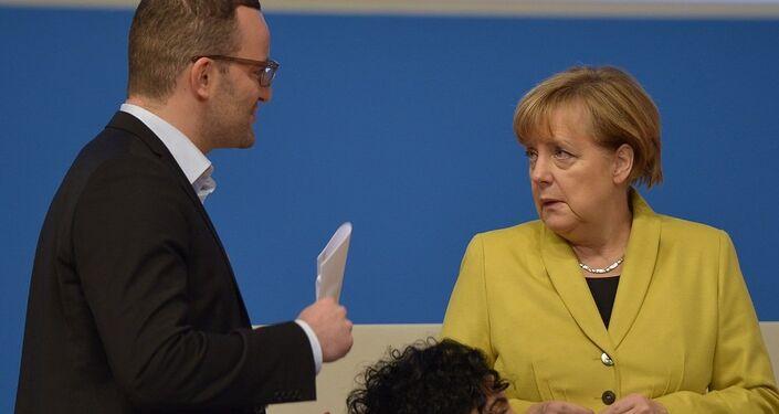Kanzlerin Angela Merkel und Jens Spahn