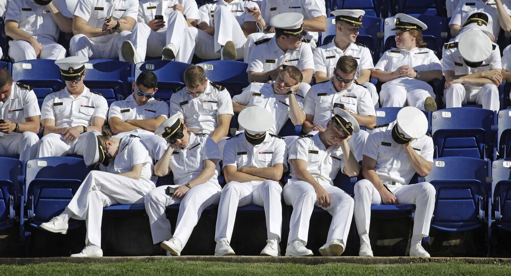 US Naval Academy midshipmen rest as they wait for the Academy's graduation and commissioning ceremony to begin in Annapolis, May 26, 2017