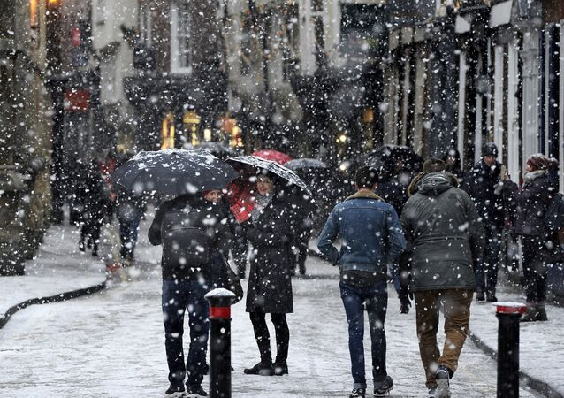 People walk through the snow in York, England (File)
