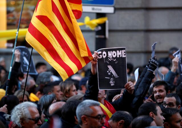 A Catalan pro-independence demonstrator holds a picture of Spain's King Felipe VI during a protest against his official reception event during the World Mobile Congress in Barcelona, Spain February 25, 2018