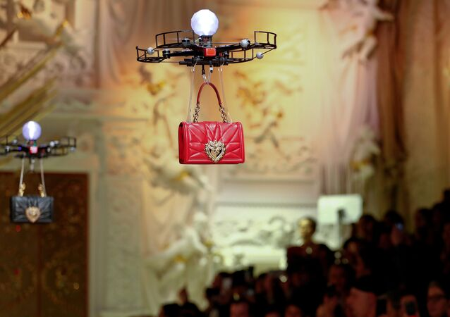 Drones carry bags, the creations from the Dolce & Gabbana Autumn/Winter 2018 women's collection during Milan Fashion Week in Milan, Italy February 25, 2018