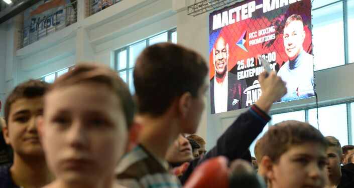 Participants in an open boxing masterclass given by boxers Mike Tyson and Kostya Tszyu at the DIVS palace of team sports, Ekaterinburg