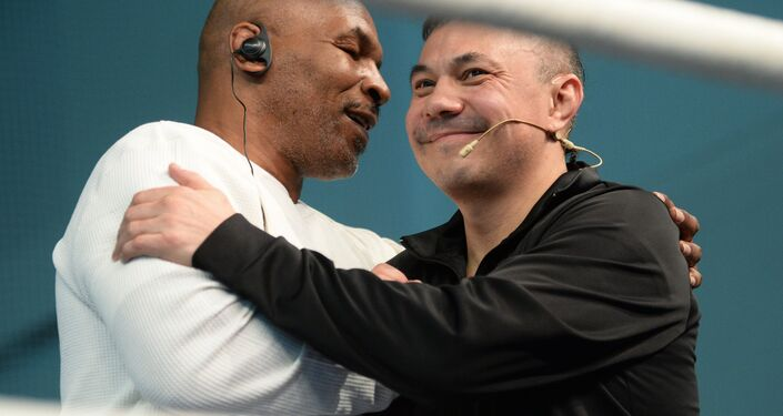 Boxers Mike Tyson, left, and Kostya Tszyu during an open boxing masterclass at the DIVS palace of team sports, Ekaterinburg