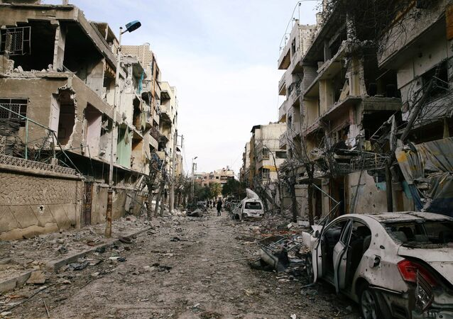 Damaged buildings are seen in the besieged town of Douma, Eastern Ghouta, Damascus, Syria February 25, 2018