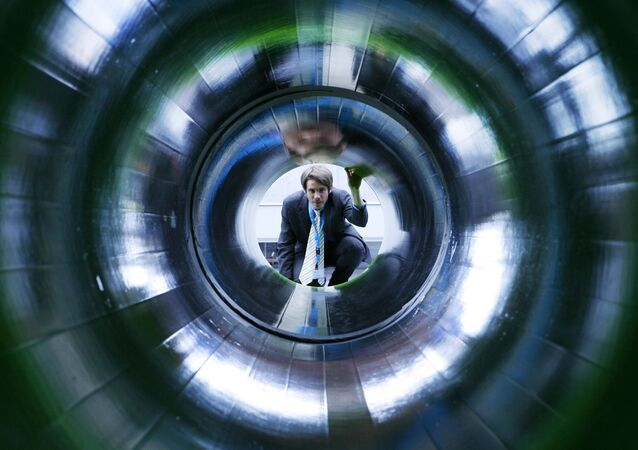 A man looks into a tube representing a natural gas pipeline at the booth of Nord Stream at the Hanover industrial fair in Hanover, Germany (File)