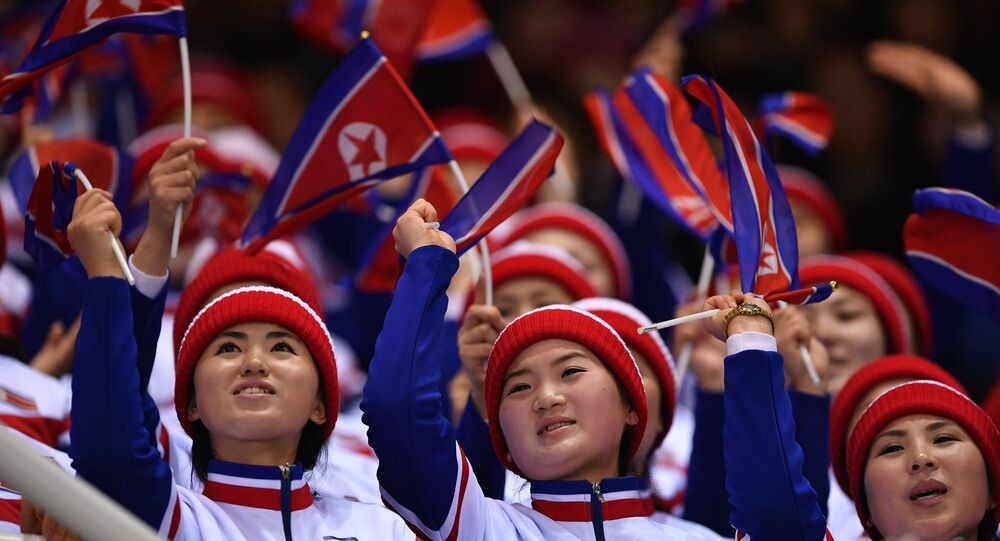 North Korean fans watch free skating performances of the pair skating competition at the XXIII Olympic Winter Games in Pyeongchang