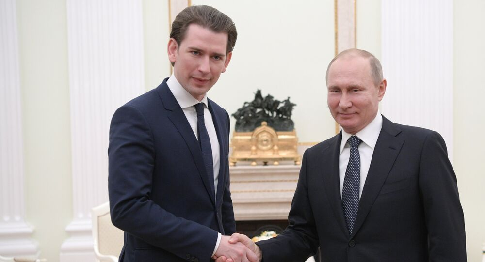 Russian President Vladimir Putin and Chancellor of Austria Sebastian Kurz, left, during a meeting