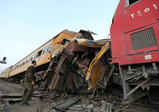 A policeman looks at the wreckage after a train crash in Kom Hamada in the northern province of Beheira, Egypt
