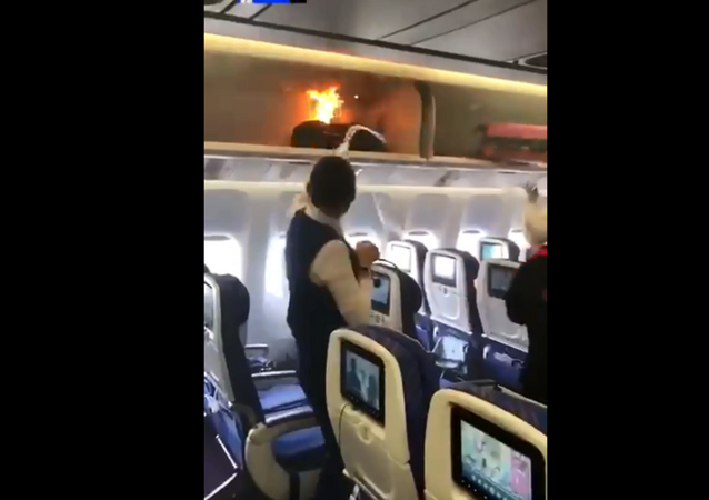 Carry-on bag inside overhead compartment on China Southern Airlines flight goes up in flames