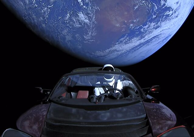SpaceX CEO Elon Musk's own car, red Tesla Roadster cabrio, entered into orbit by the Falcon Heavy launcher, with a dummy wearing a spacesuit at the steering wheel, in outer space