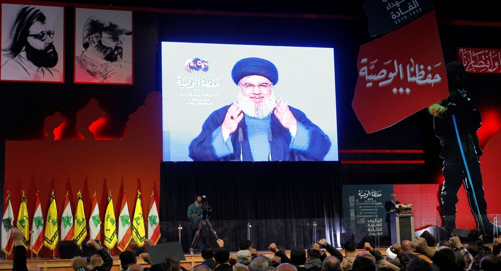Lebanon's Hezbollah leader Sayyed Hassan Nasrallah is seen on a video screen as he addresses his supporters in Beirut, Lebanon February 16, 2018