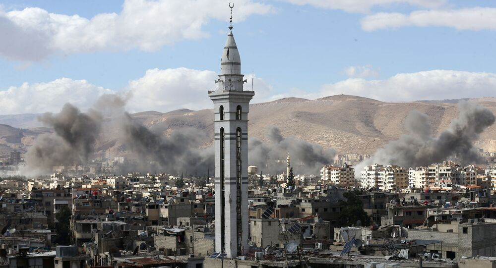 Smoke rises from the besieged Eastern Ghouta in Damascus, Syria