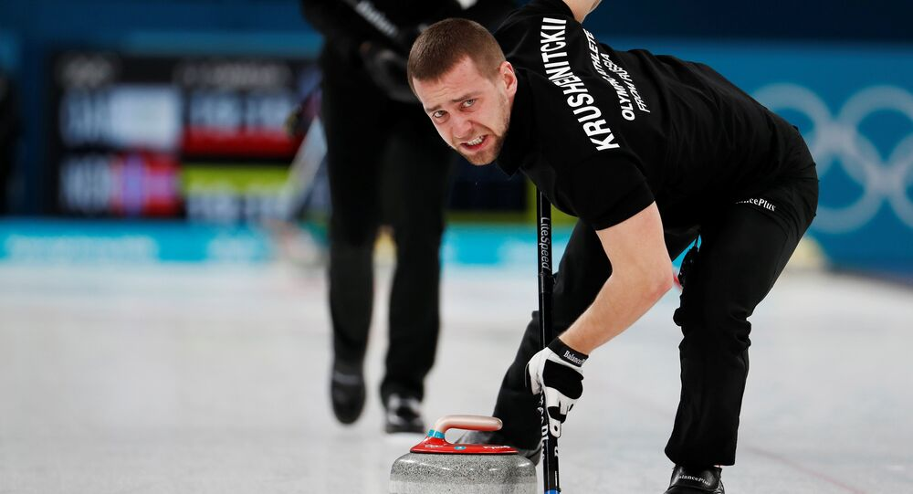 Curling Pyeongchang 2018 Winter Olympics Mixed Doubles Bronze Medal Match - Olympic Athletes from Russia v Norway - Gangneung Curling Center - Gangneung, South Korea February 13, 2018 - Alexander Krushelnitsky, an Olympic athlete from Russia, sweeps
