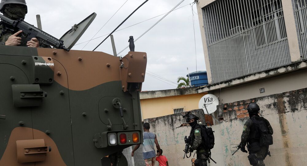 Armed forces members patrol during an operation against drug dealers in Coreia slum, in Rio de Janeiro, Brazil