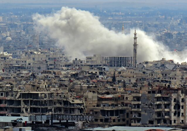 A general view taken from a government-held area in Damascus shows smoke rising from the rebel-held enclave of Eastern Ghouta on the outskirts of the Syrian capital following fresh air strikes and rocket fire on February 27, 2018